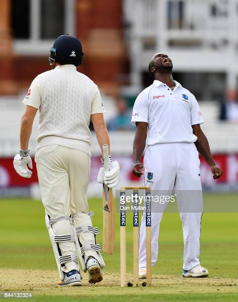 Kemar Roach of the West Indies celebrates taking the wicket of Jonny Bairstow of England during day two of the 3rd Investec Test Match between...