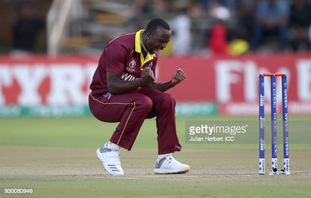 Kemar Roach of The West Indies celebrates the wicket of Kevin O'Brien of Ireland during The ICC Cricket World Cup Qualifier between The West Indies...