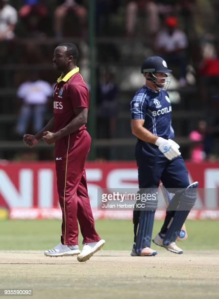 Kemar Roach of the West Indies celebrates the wicket of Kyle Coetzer of Scotland during The ICC Cricket World Cup Qualifier between the West Indies...