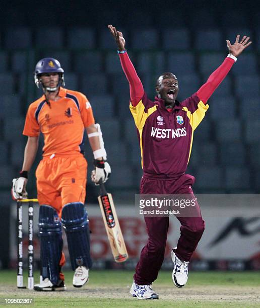 Kemar Roach of West Indies appeals successfully for the wicket of Pieter Seelaar of the Netherlands during the 2011 ICC World Cup group B match...