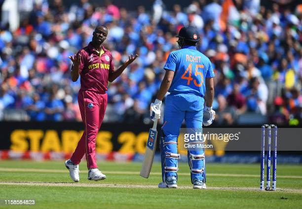 Kemar Roach of West Indies celbrates dismissing Rohit Sharma of India during the Group Stage match of the ICC Cricket World Cup 2019 between West...