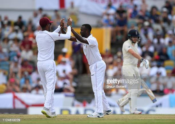 Kemar Roach of West Indies celebrates after taking the wicket of Jonny Bairstow of England during Day Two of the First Test match between England and...
