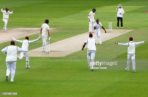 Kemar Roach of West Indies celebrates after taking the wicket of Dominic Sibley of England during Day One of the Ruth Strauss Foundation Test, the...