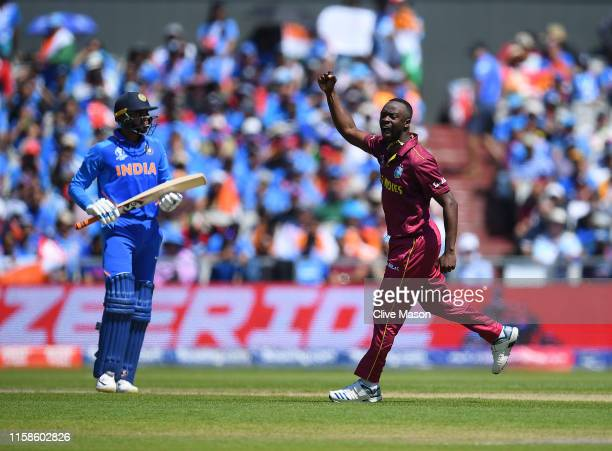 Kemar Roach of West Indies celebrates dismissing Vijay Shankar of India during the Group Stage match of the ICC Cricket World Cup 2019 between West...