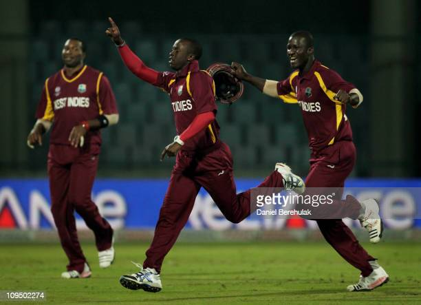 Kemar Roach of West Indies celebrates his hat trick and winning the game with captain Darren Sammy during the 2011 ICC World Cup group B match...