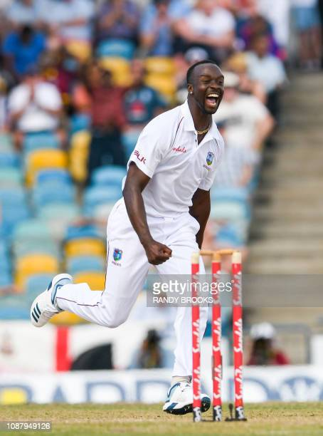 Kemar Roach of West Indies celebrates the dismissal of Jos Buttler of England during day 2 of the 1st Test between West Indies and England at...