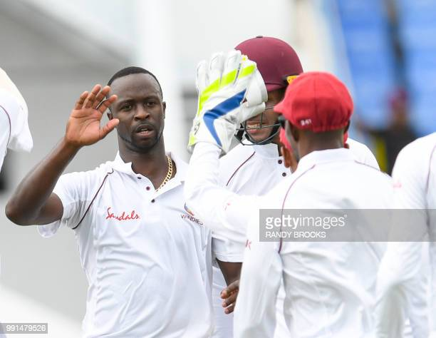 Kemar Roach of West Indies celebrates the dismissal of Shakib Al Hasan of Bangladesh during day 1 of the 1st Test between West Indies and Bangladesh...