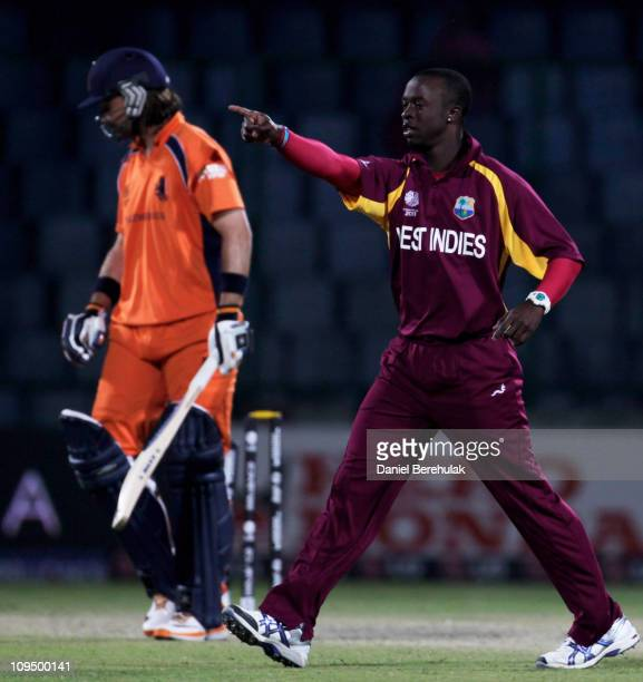 Kemar Roach of West Indies celebrates the wicket of Bas Zuiderent of the Netherlands during the 2011 ICC World Cup group B match between Netherlands...