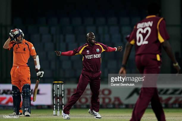 Kemar Roach of West Indies celebrates the wicket of Pieter Seelaar of the Netherlands during the 2011 ICC World Cup group B match between Netherlands...