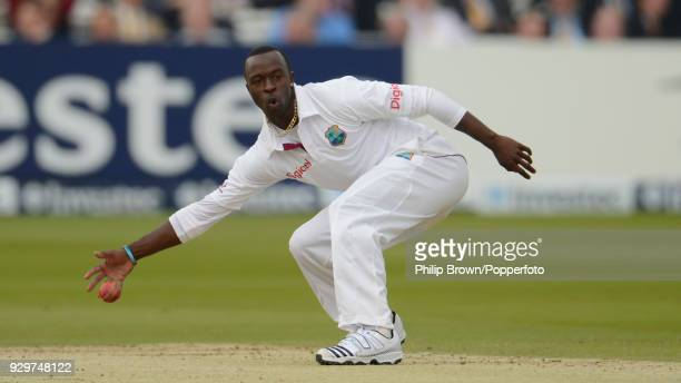 Kemar Roach of West Indies fields the ball off his own bowling during the 1st Test match between England and West Indies at Lord's Cricket Ground...
