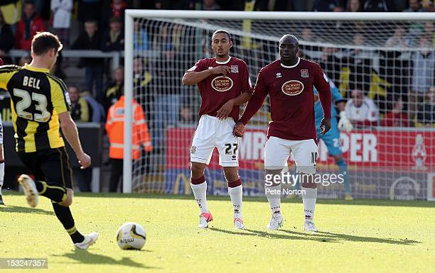 Kemar Roofe Adebayo Akinfenwa of Northampton Town form a defencive wall during the npower League Two match between Burton Albion and Northampton Town...