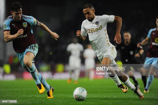 Kemar Roofe of Leeds and Kevin Long of Burnley in action during the Carabao Cup Third Round match between Burnley and Leeds United at Turf Moor on...