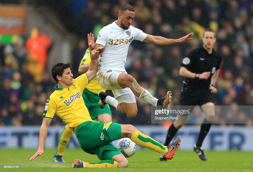 Kemar Roofe of Leeds United and Timm Close of Norwich City compete for the ball during the Sky Bet Championship match between Norwich City and Leeds United at Carrow Road on April 28, 2018 in Norwich, England.
