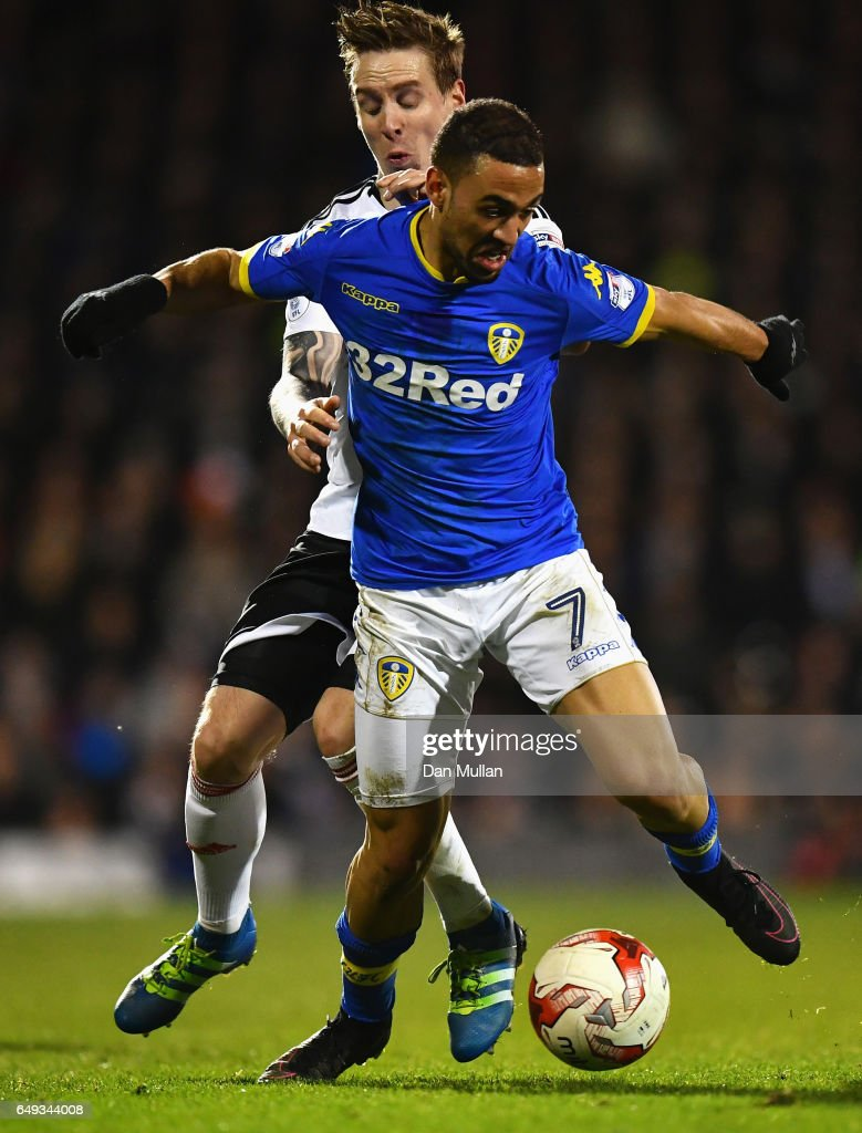 Kemar Roofe of Leeds United holds off Stefan Johansen of Fulham during the Sky Bet Championship match between Fulham and Leeds United at Craven Cottage on March 7, 2017 in London, England.