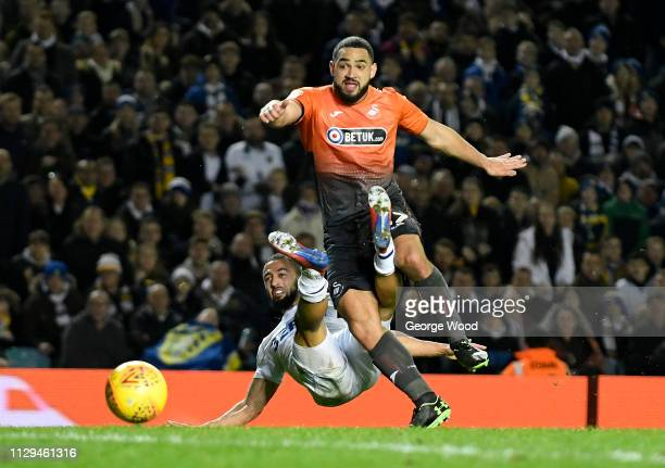 Kemar Roofe of Leeds United is tackled by Cameron CarterVickers of Swansea City compete for the ball during the Sky Bet Championship match between...