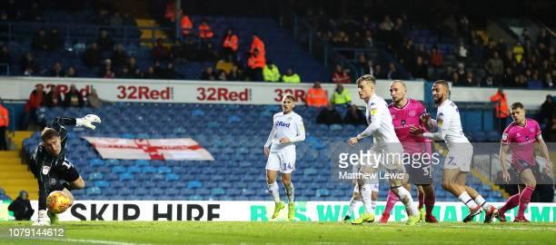 Kemar Roofe of Leeds United sot beats Joe Lumley of Queens Park Rangers during the Sky Bet Championship match between Leeds United and Queens Park...