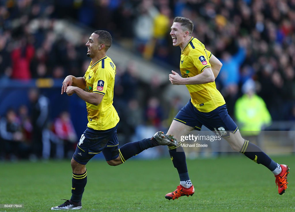 Kemar Roofe (L) of Oxford United celebrates after scoring his team's second goal during The Emirates FA Cup third round match between Oxford United and Swansea City at the Kassam Stadium on January 10, 2016 in Oxford, England.