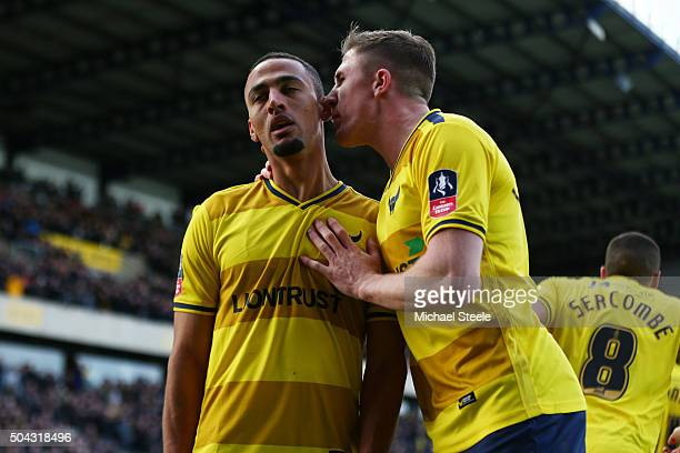 Kemar Roofe of Oxford United is congratulated by Liam Sercombe of Oxford United after scoring hois team's third goal during The Emirates FA Cup third...