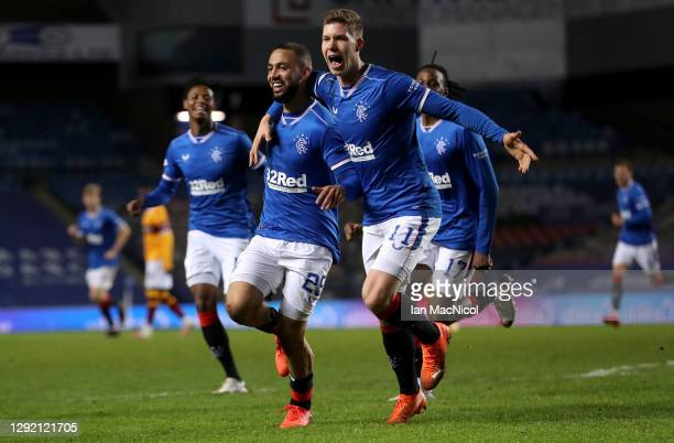Kemar Roofe of Rangers celebrates with teammate Cedric Itten after scoring their team's third goal during the Ladbrokes Scottish Premiership match...