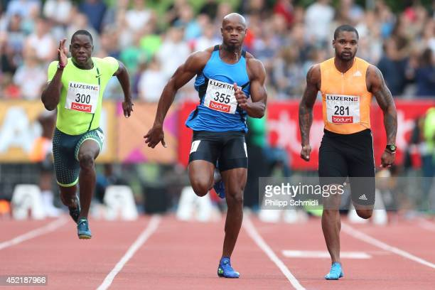 Kemarley Brown Asafa Powell and Keston Bledman compete in the Men's 100m race at the EAA Premium Meeting Lucerne on July 15 2014 in Lucerne...