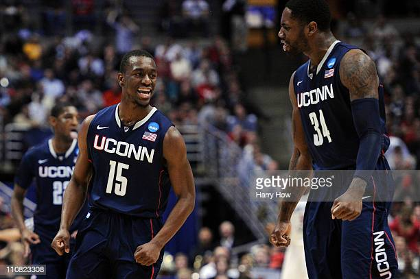 Kemba Walker and Alex Oriakhi of the Connecticut Huskies celebrate after a play against the San Diego State Aztecs during the west regional semifinal...