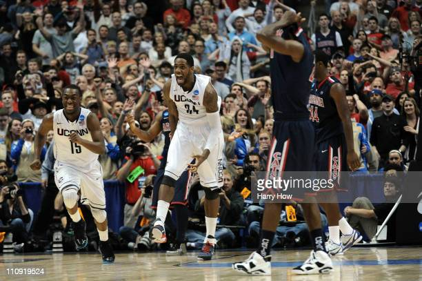 Kemba Walker and Alex Oriakhi of the Connecticut Huskies celebrate after defeating the Arizona Wildcats during the west regional final of the 2011...