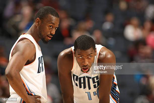 Kemba Walker and Michael KiddGilchrist of the Charlotte Bobcats share a word during the game against the Orlando Magic at the Time Warner Cable Arena...