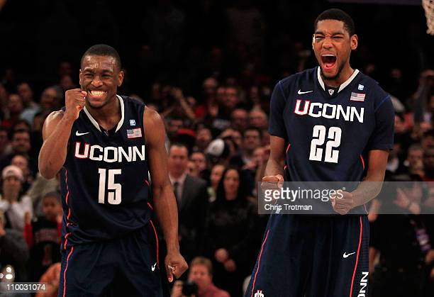 Kemba Walker and Roscoe Smith of the Connecticut Huskies celebrate late in the game against the Louisville Cardinals during the championship of the...