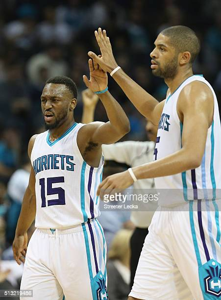 Kemba Walker and teammate Nicolas Batum of the Charlotte Hornets react after a play during their game against the Phoenix Suns at Time Warner Cable...