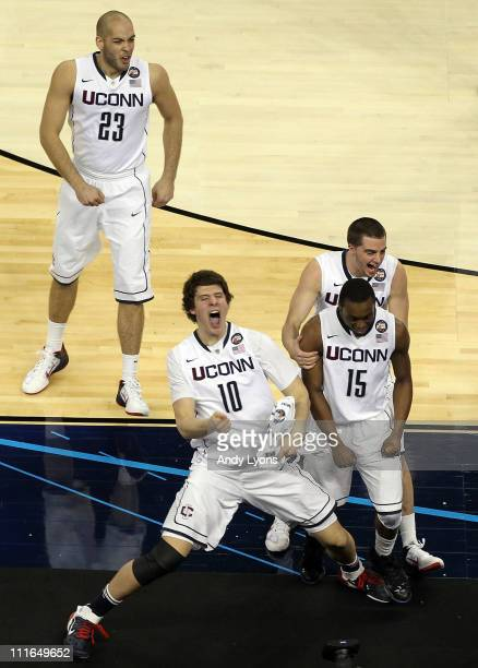 Kemba Walker Benjamin Stewart Tyler Olander and Kyle Bailey of the Connecticut Huskies react after defeating the Butler Bulldogs to win the National...