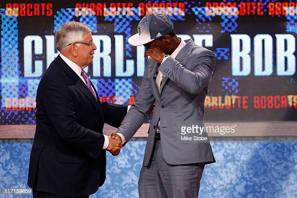Kemba Walker from UCONN is overcomer with emotion as he greets NBA Commissioner David Stern after he was selected overall by the Charlotte Bobcats in...