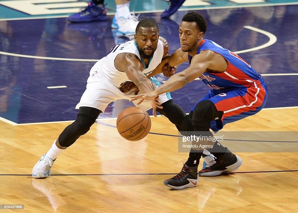 Kemba Walker (L) of Charlotte Hornets and Ish Smith (R) of Detroit Pistons fight for the ball during the NBA match between Detroit Pistons and Charlotte Hornets at the Spectrum Arena in Charlotte, NC, USA on December 7, 2016.
