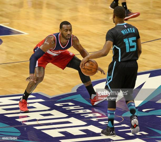 Kemba Walker of Charlotte Hornets faces John Wall of Washington Wizards during the NBA match between Washington Wizards and Charlotte Hornets at the...