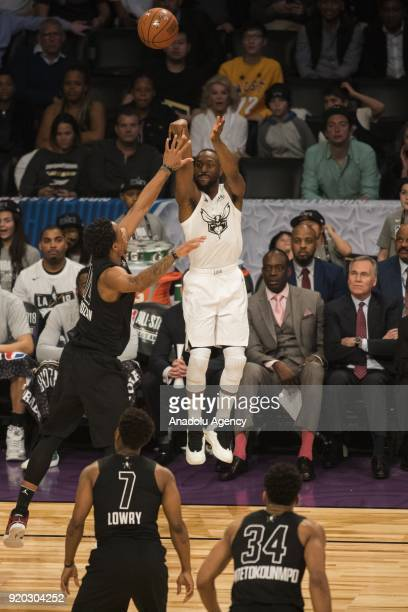 Kemba Walker of Team Lebron shoots a threepointer in the second quarter as DeMar DeRozan of Team Stephen looks for the block during the 2018 NBA...