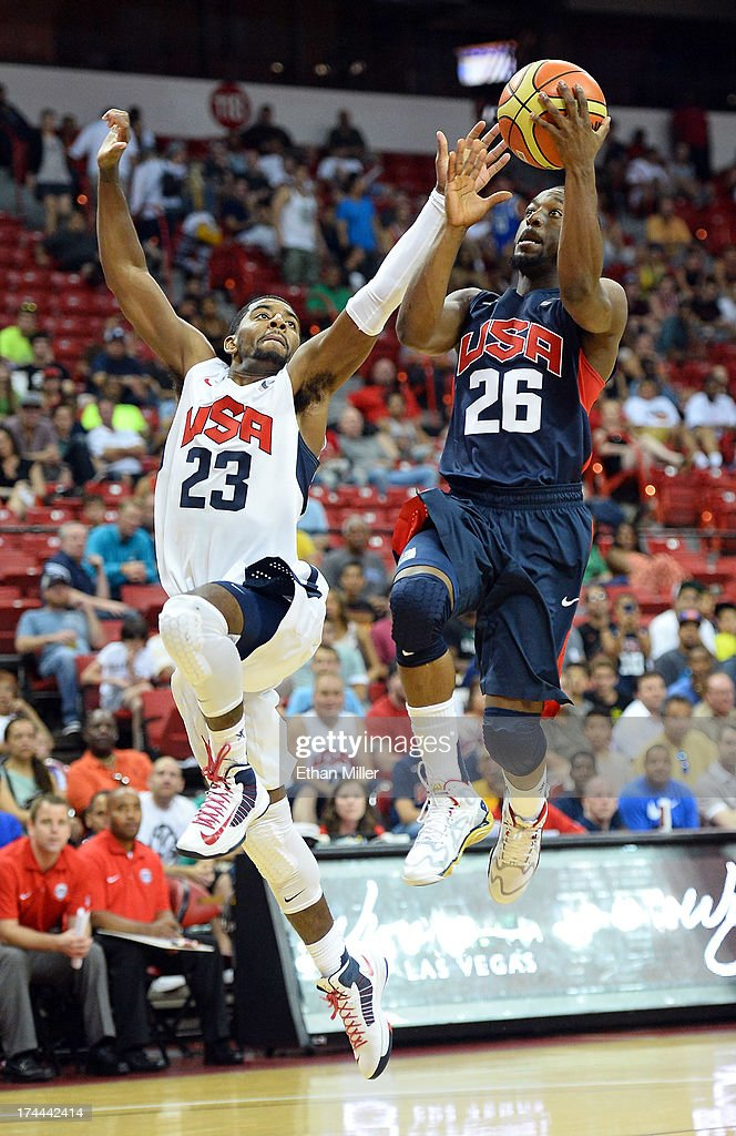 Kemba Walker #26 of the 2013 USA Basketball Men's National Team drives against Kyrie Irving #23 of the 2013 USA Basketball Men's National Team during a USA Basketball showcase at the Thomas & Mack Center on July 25, 2013 in Las Vegas, Nevada.