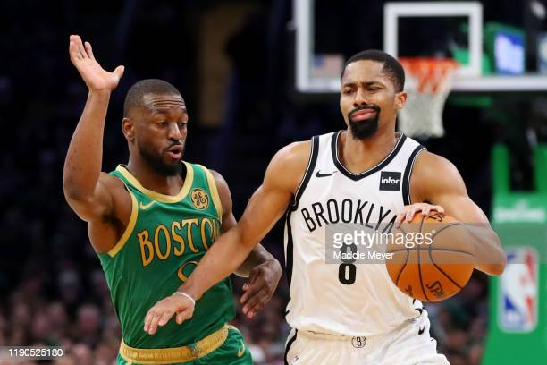 Kemba Walker of the Boston Celtics defends Spencer Dinwiddie of the Brooklyn Nets during the second half at TD Garden on November 27 2019 in Boston...