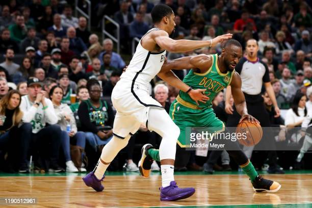 Kemba Walker of the Boston Celtics dribbles past Spencer Dinwiddie of the Brooklyn Nets during the first half at TD Garden on November 27 2019 in...