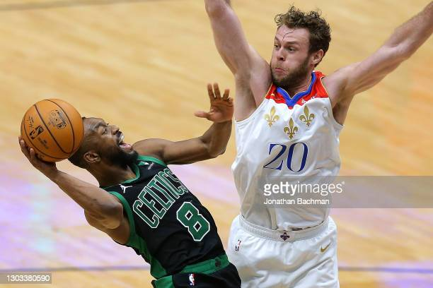 Kemba Walker of the Boston Celtics drives against Nicolo Melli of the New Orleans Pelicans during the second half at the Smoothie King Center on...