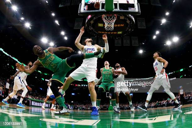 Kemba Walker of the Boston Celtics falls after taking a shot against Ivica Zubac of the LA Clippers at TD Garden on February 13, 2020 in Boston,...