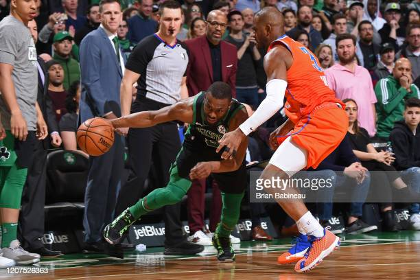 Kemba Walker of the Boston Celtics handles the ball while Chris Paul of the Oklahoma City Thunder plays defense on March 8 2020 at the TD Garden in...