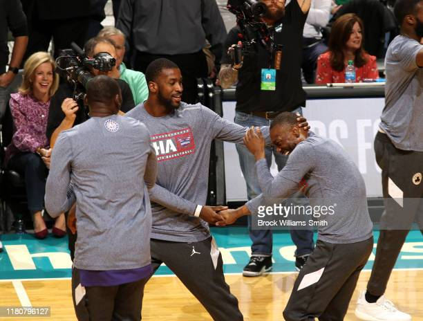 Kemba Walker of the Boston Celtics is greeted by Michael KiddGilchrist of the Charlotte Hornets on November 7 2019 at Spectrum Center in Charlotte...