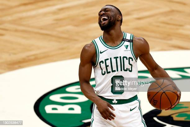 Kemba Walker of the Boston Celtics laughs during the fourth quarter against the Denver Nuggets at TD Garden on February 16, 2021 in Boston,...