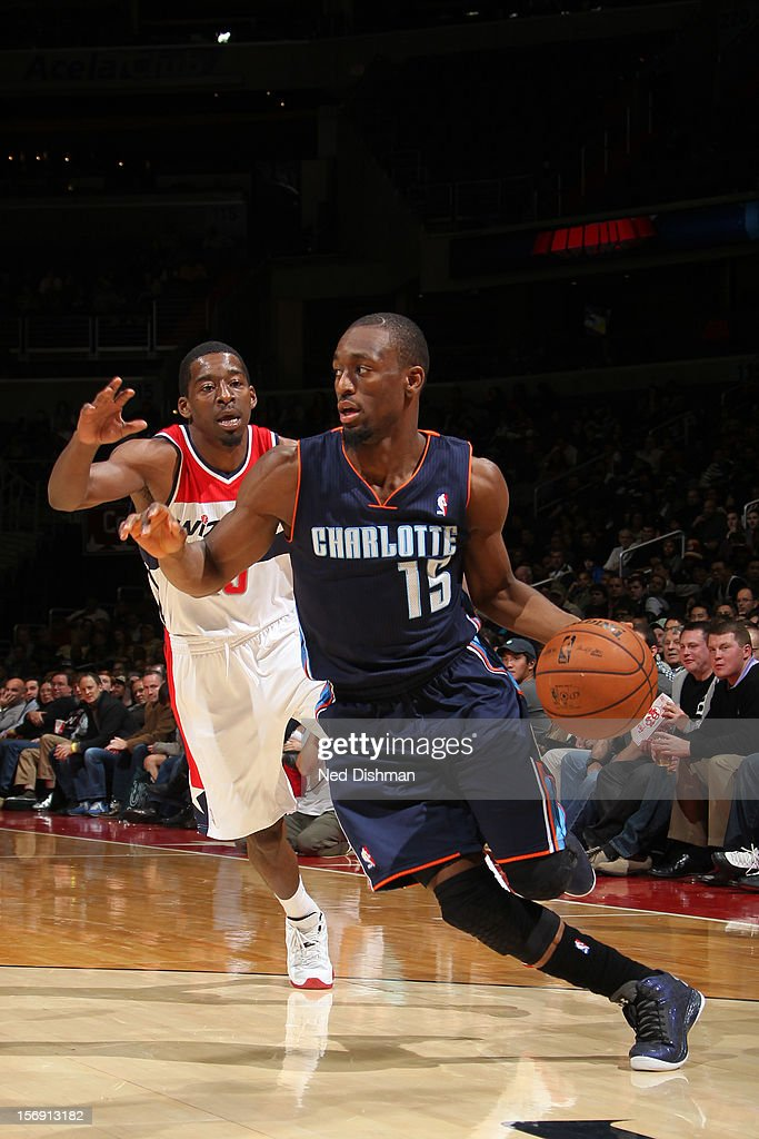 Kemba Walker #15 of the Charlotte Bobcats drives against Jordan Crawford #15 of the Washington Wizards during the game at the Verizon Center on November 24, 2012 in Washington, DC.