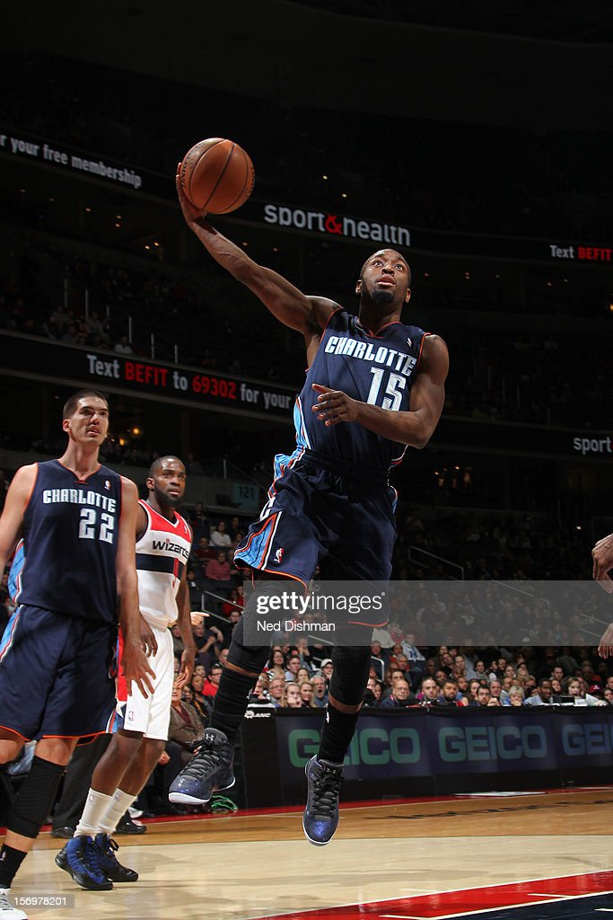 Kemba Walker #15 of the Charlotte Bobcats drives to the basket against the Washington Wizards during the game at the Verizon Center on November 24, 2012 in Washington, DC.