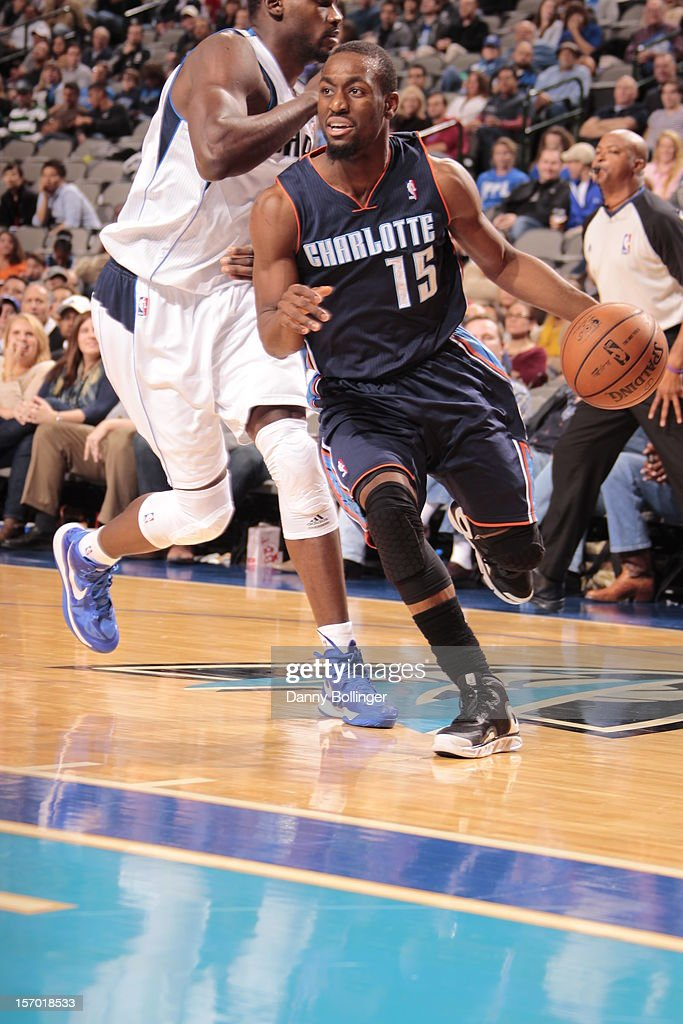 Kemba Walker #15 of the Charlotte Bobcats drives to the basket against the Dallas Mavericks on October 26, 2012 at the American Airlines Center in Dallas, Texas.