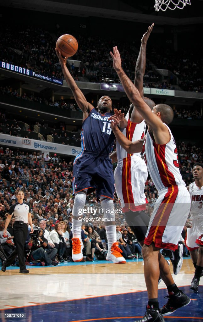 Kemba Walker #15 of the Charlotte Bobcats goes to the basket during the game between the Miami Heat and the Charlotte Bobcats at the Time Warner Cable Arena on December 26, 2012 in Charlotte, North Carolina.