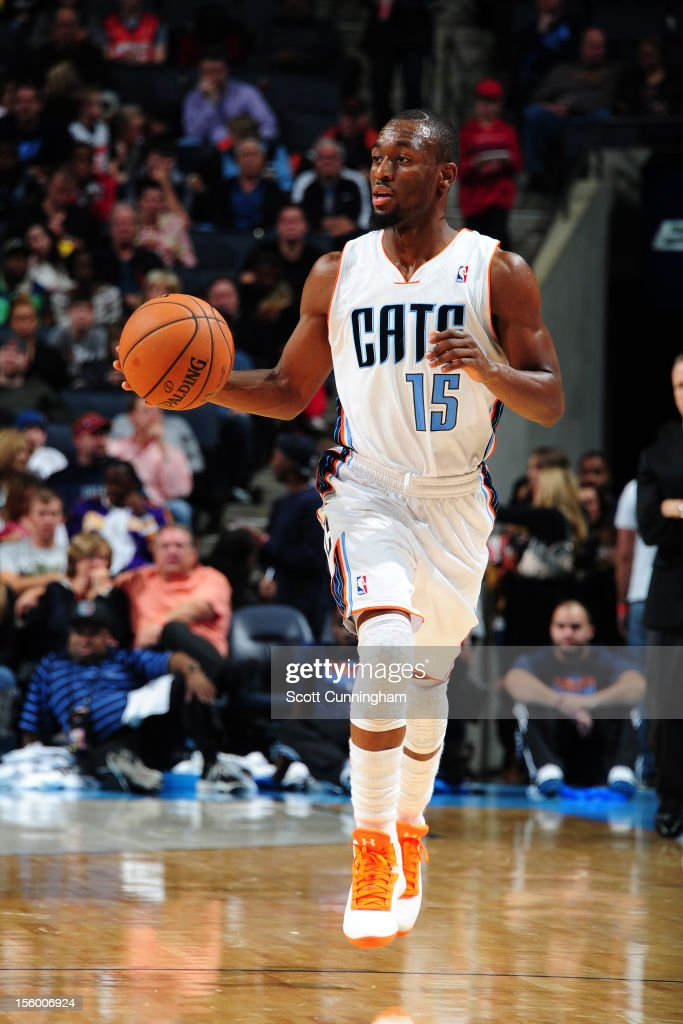 Kemba Walker #15 of the Charlotte Bobcats looks up the court against the Dallas Mavericks at Time Warner Cable Arena on November 10, 2012 in Charlotte, North Carolina.
