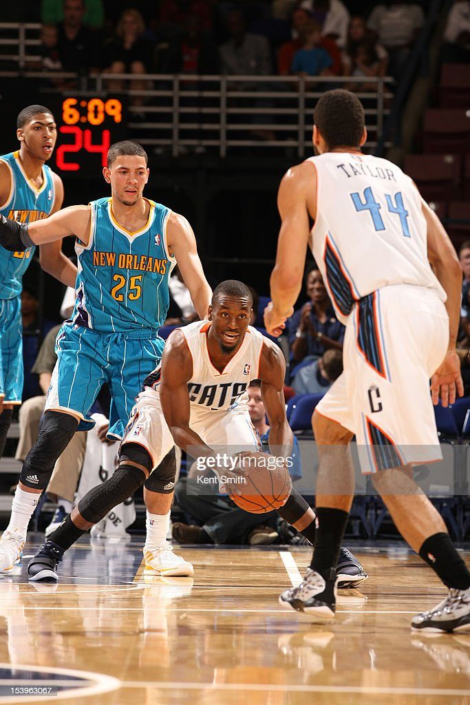 Kemba Walker #15 of the Charlotte Bobcats makes a pass to teammate Jeffery Taylor #44 during the game against the New Orleans Hornets at the North Charleston Coliseum on October 11, 2012 in North Charleston, South Carolina.