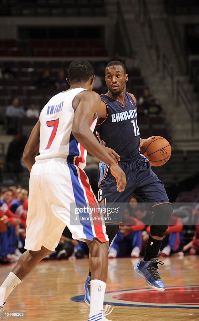 Kemba Walker #15 of the Charlotte Bobcats protects the ball from Brandon Knight #7 of the Detroit Pistons during the pre-season game between the Charlotte Bobcats and the Detroit Pistons on October 20, 2012 at The Palace of Auburn Hills in Auburn Hills, Michigan.