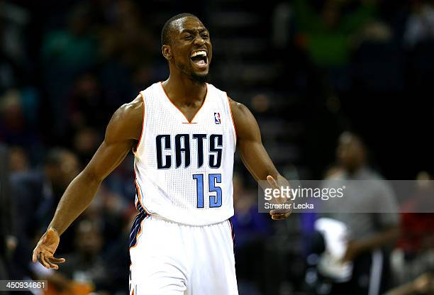 Kemba Walker of the Charlotte Bobcats reacts after making a basket during their game against the Brooklyn Nets at Time Warner Cable Arena on November...
